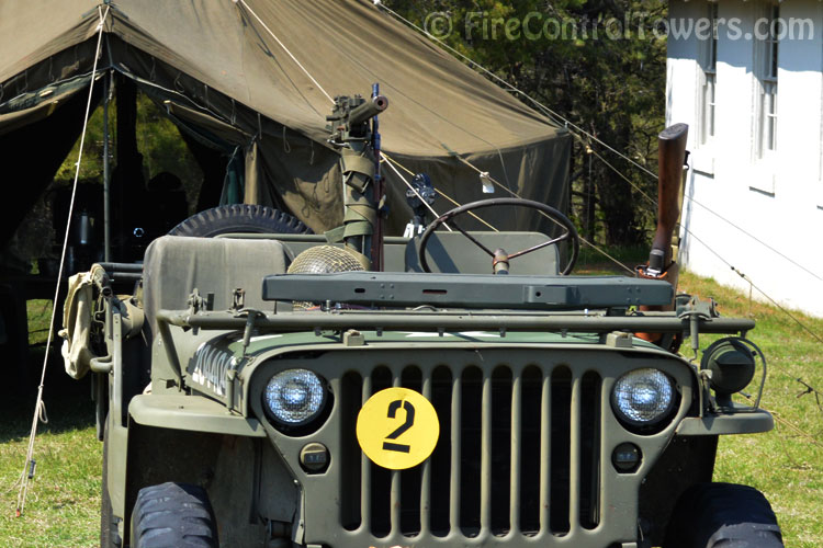 Army jeep with mounted and side-holstered machine guns